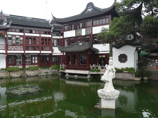 Shanghai, China housing by pond